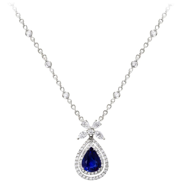 Pear Shape Blue Sapphire and Diamond Halo Pendant Necklace