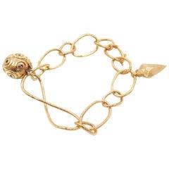 Infinity Yellow Gold Charm Bracelet by Paola Ferro