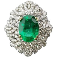 Certified Insignificant Oil 4.95 Carat Oval Emerald and Diamond Cocktail Ring