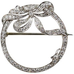 Art Deco Platinum and Diamond Bow Motif Brooch