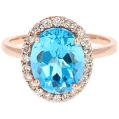 4.92 Carat Rose Gold Blue Topaz Diamond Ring
