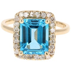 4.61 Carat Yellow Gold Blue Topaz Diamond Ring