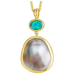 Australian Lightening Ridge Opal Mabe Pearl gold pendant