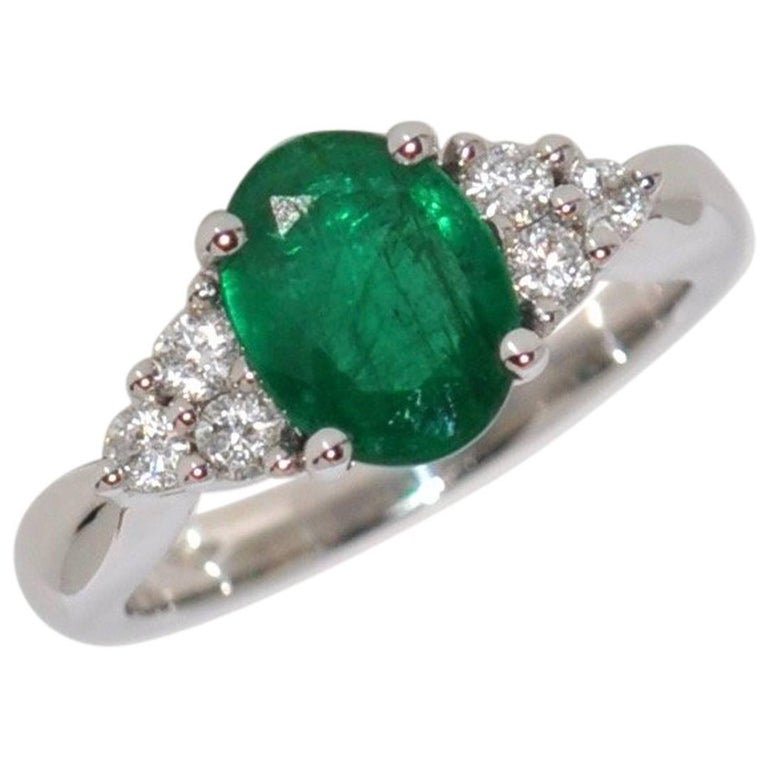 Emerald and White Diamonds White Gold Engagement Ring