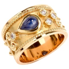 1990s Teardrop Blue Sapphire Diamond Yellow Gold Wide Cocktail Ring