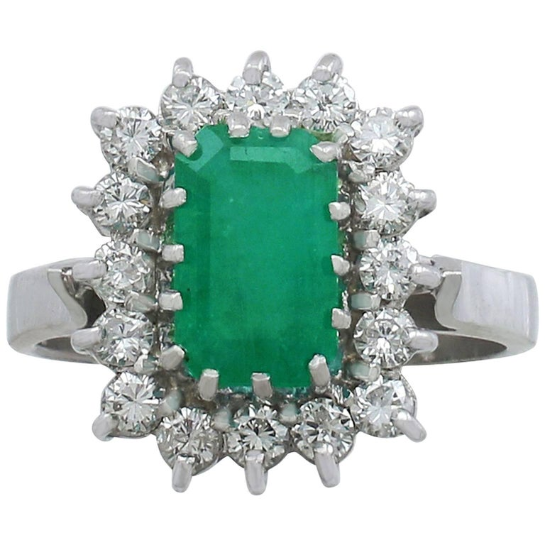 1980s Emerald and Diamond White Gold Cluster Ring