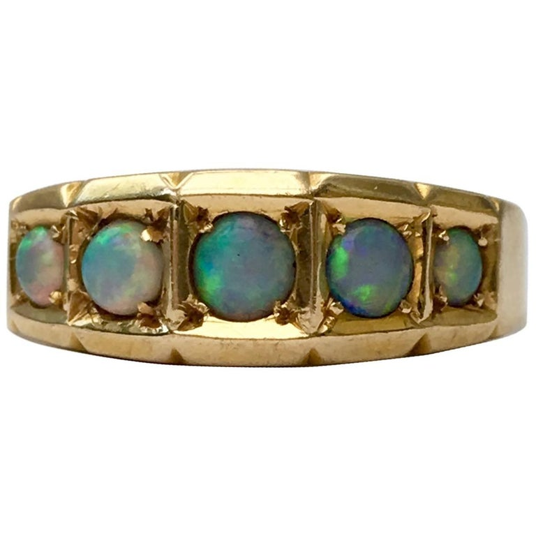 Late Victorian Opal 18 Carat Gold Five-Stone Antique Band Ring