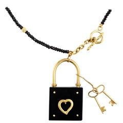 18 Karat Gold and Black Onyx Heart Podlock Pendant