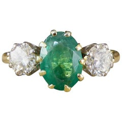 1930s Emerald and Diamond Engagement Ring in 18 Carat Yellow Gold