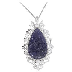 11.70 Pear Shaped Carved Iolite and Diamond Pendant