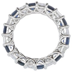 Open Blue Sapphire and White Diamond Infinity Band
