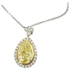 GIA Certified 1.51 Carat Pear Shape Yellow Diamond Pendant