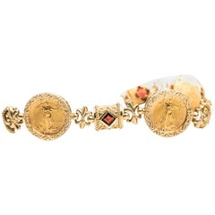 1990s Gold Coin and Garnet Fleur de Lis Link 14 Karat Gold Bracelet