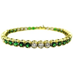Tsavorite and Diamond Yellow Gold Tennis Bracelet