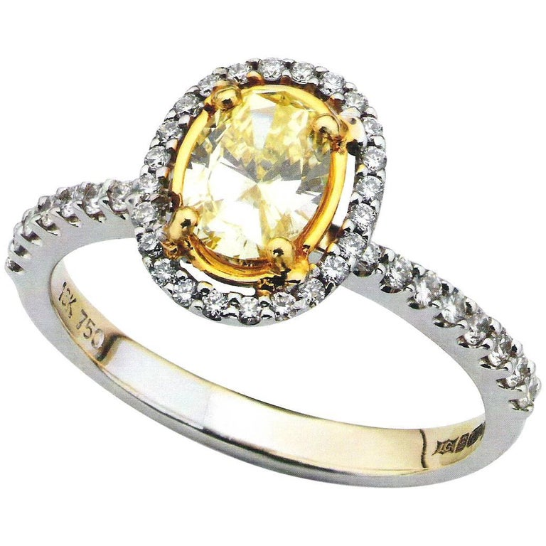 Yellow Oval Diamond 18 Carat White Gold Halo Engagement Ring