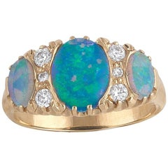 18 Carat Gold Opal Three-Stone and Diamond Ring