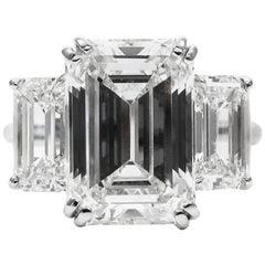 7.08 Carat Total Three-Stone Emerald Cut Diamond and Platinum Ring GIA