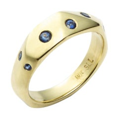 Sapphire and 18 Karat Yellow Gold Faceted Band