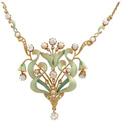 1900s 1.42 Carat Diamond and Seed Pearl Enamel Yellow Gold Necklace