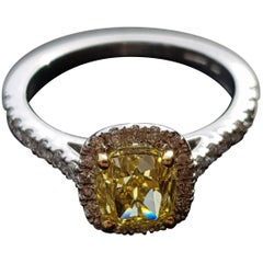 Fancy Intense Yellow Diamond Ring with a Halo and Pavé Stones on the Shoulders