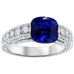 Natural Blue Sapphire and Diamond Semi Bezel Engagement Ring