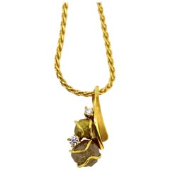 14K gold necklace with 18k gold pendant with diamonds and rough diamond, 1990's
