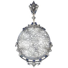 Artistic looking Round Craved Jade Pendant with Diamonds and Sapphire