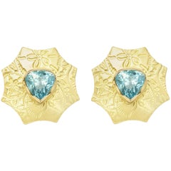 8.73 ct Trilliant Cut Blue Zircon and 18kt Gold Sand Dollar Earrings with Omegas
