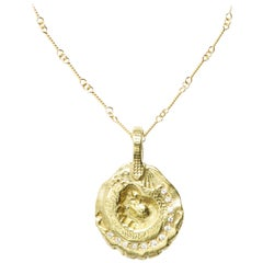 Diamond and 18 Karat Gold Nautilus Pendant