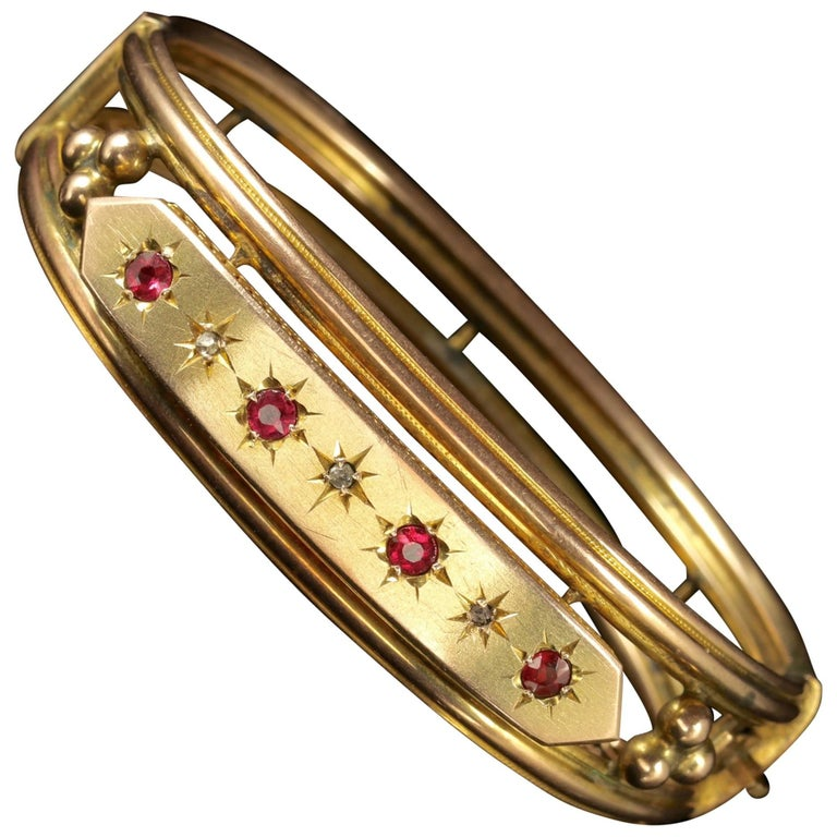 Antique Victorian 9 Carat Gold Star Set Ruby Diamond Bangle, circa 1900 For Sale