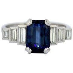 Vintage 18 Karat Gold Ladies Ring with Blue Sapphire and Diamonds, circa 1970s