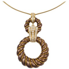 1970s Chaumet Diamond Bronze and Gold Pendant