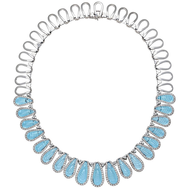 Aqua collection 18kt white Gold Necklace and Earrings White Diamonds and Topaze