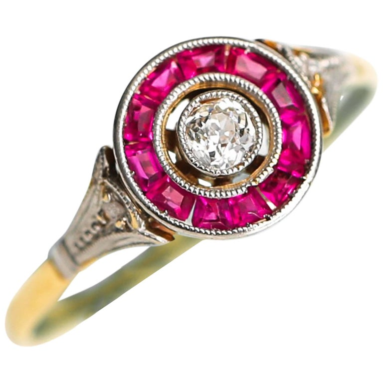 1920s 0.25 Carat Old Mine Diamond and Ruby Halo 14 Karat Yellow Gold Ring