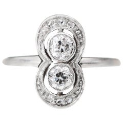 1920s 0.60 Carat Total Weight Diamond Engagement Ring Platinum and 14 Karat Gold
