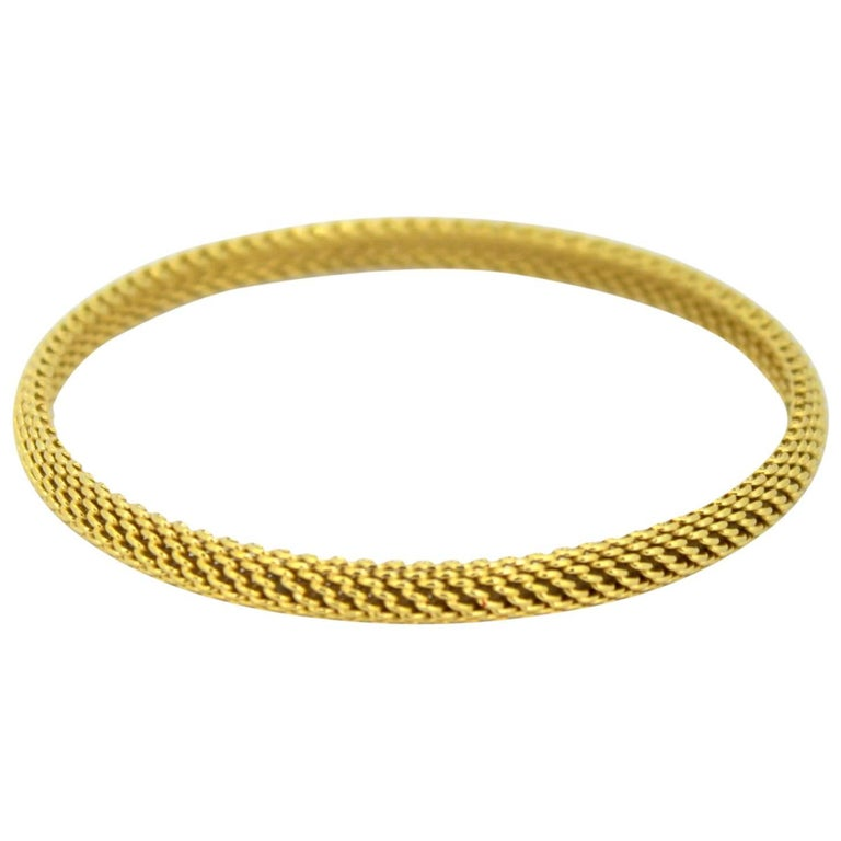 Tiffany & Co. Vintage 18 Karat Yellow Gold Ladies Bangle, circa 2000 For Sale
