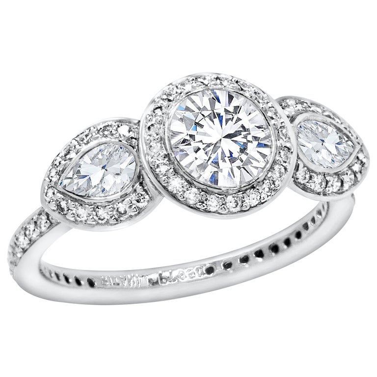 Round Diamond Three-Stone Halo Engagement Ring For Sale