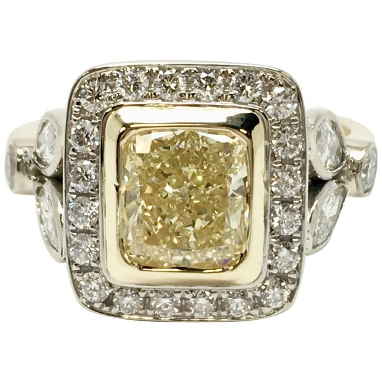 Fancy Yellow 1.66 Carat Cushion Cut Diamond Ring For Sale