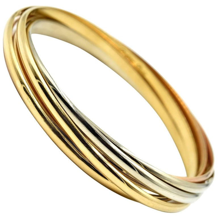 Cartier Trinity Seven Bangles Bracelet Tri-Tone 18 Karat Gold For Sale