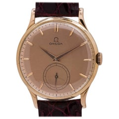 Omega Pink Gold salmon dial Manual Wind Wristwatch, circa 1950s