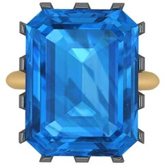 Natural Blue Topaz Emerald Cut in a Two-Tone 18 Karat Yellow and Black Gold