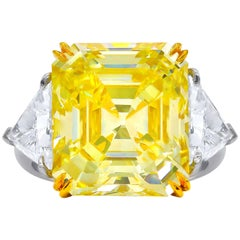 GIA Certified 13.14 Carat Fancy Yellow, VVS2 Asscher Cut Diamond