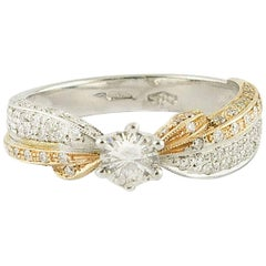 18 Karat Gold Solitaire Ring with Diamonds