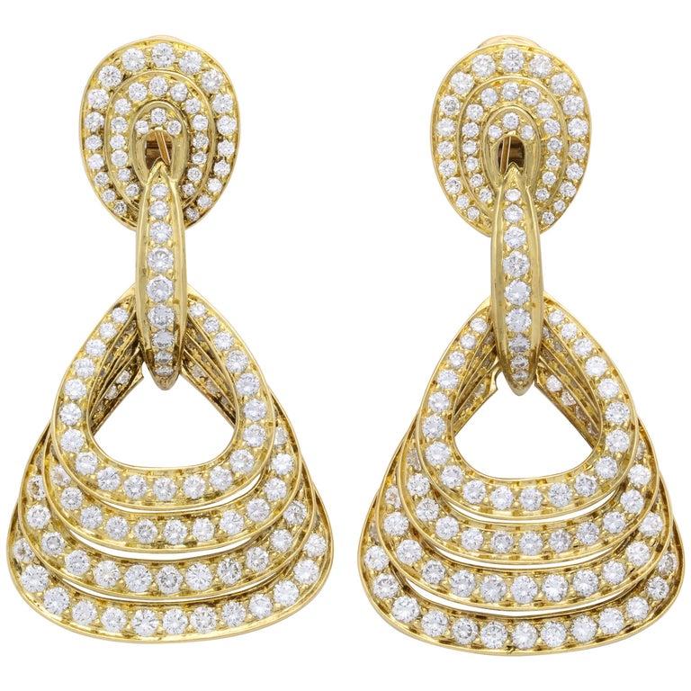 Graduating Quadruple Diamond and 18 Karat Yellow Gold Pendant Earrings