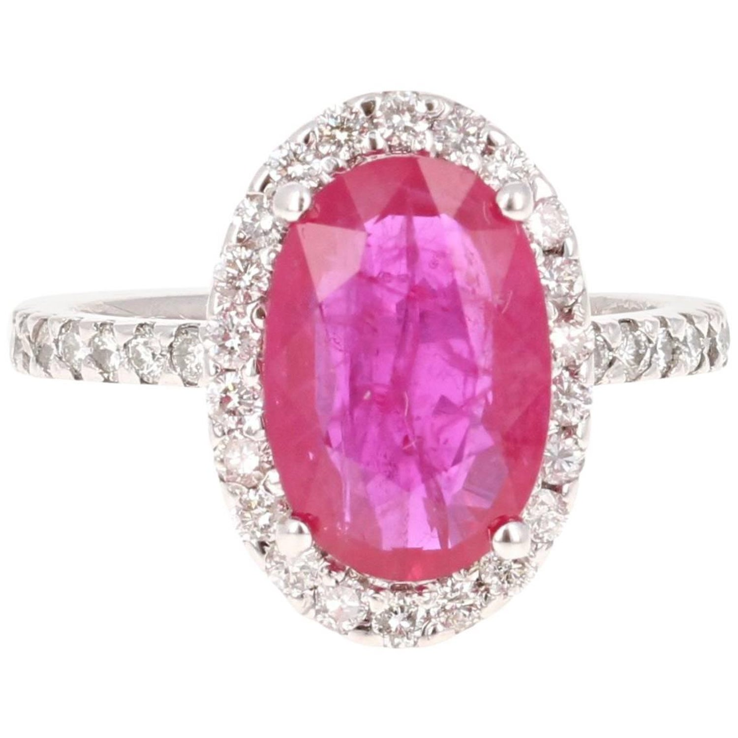 Oval Ruby and Diamonds Halo Ring For Sale at 1stdibs