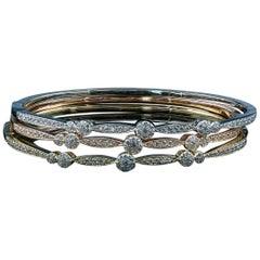 Stackable 18 Karat Gold and Diamond Bangles Featuring 0.65 Carat of VS Diamonds