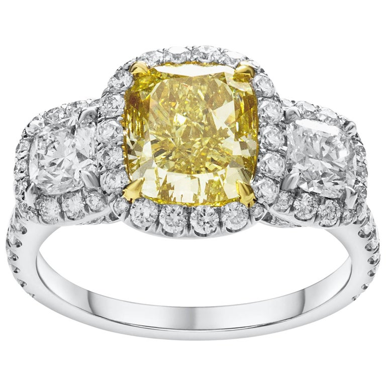 GIA Certified Fancy Yellow Diamond Three-Stone Halo Engagement Ring