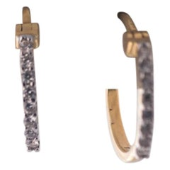 Diamond and 18 Karat Yellow Gold Mini Hoop Earrings