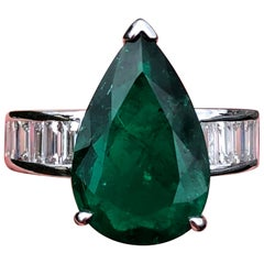 Four Carat Pear Cut, Colombian Emerald Flanked with Diamonds & Set in White Gold