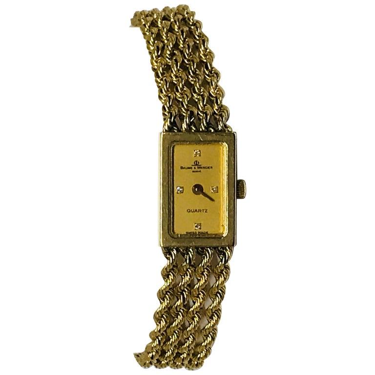Ladies 14 Karat Gold and Diamond Baume & Mercier Watch
